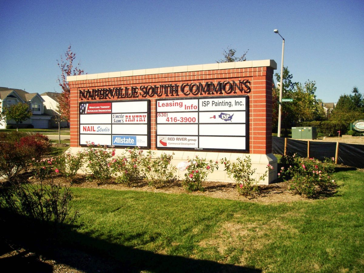 A monument sign with the names and logos of multiples business, representing how one can benefit from calling a Chicago sign company.