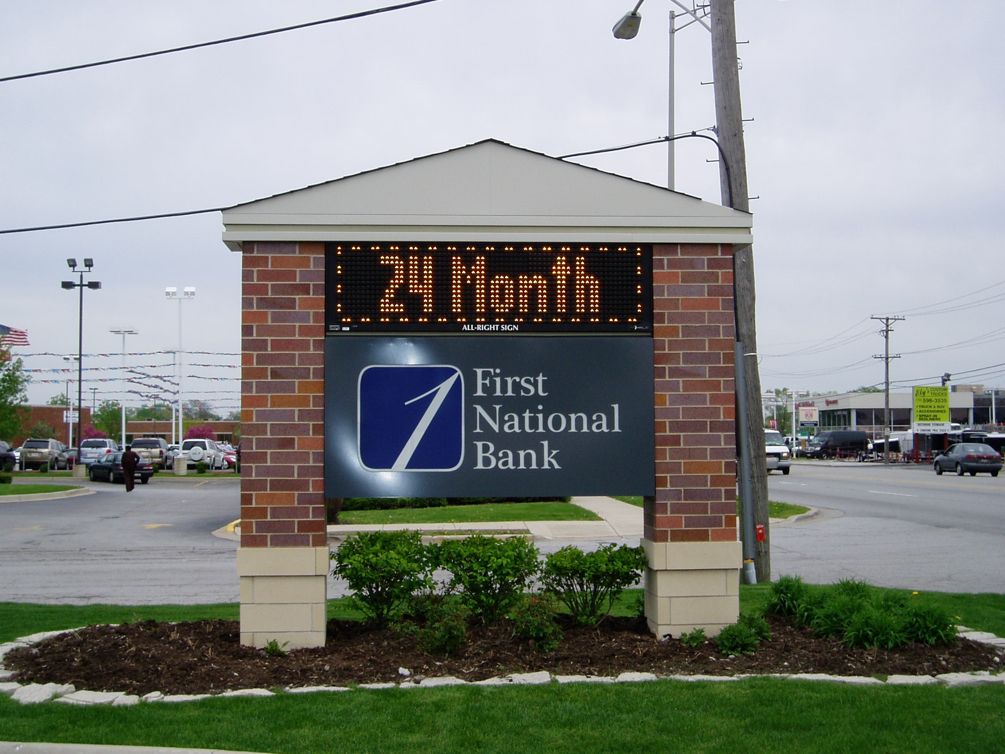A monument, digital sign outside of a bank, representing how one can benefit from calling a Tinley Park commercial sign company.